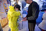 A Japanese man is tested for radiation outside a health center in Minami-Soma, Fukushima Prefecture, Japan on 30 March, 2011.  Photographer: Robert Gilhooly