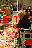 Roma, .Supermercato Coop Laurentino.Anziana al banco carne.Rome.Supermarket Coop Laurentino.Elderly woman to the meat department.Rome.Supermarket Coop Laurentino.Purchase of panettone for Christmas