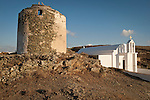 White Orthodox chapel by windmill ruins and stone walls, Pano Meria, Folegandros, Cyclades, Greece
