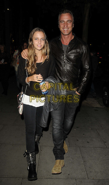 "JOY & DAVID GINOLA  .The ""Rock Of Ages The Musical"" gala night, Shaftesbury theatre, Shaftesbury Avenue, London, England..28th September 2011.full length black arm over shoulder leather jacket daughter father dad family jeans denim top .CAP/CAN.©Can Nguyen/Capital Pictures."