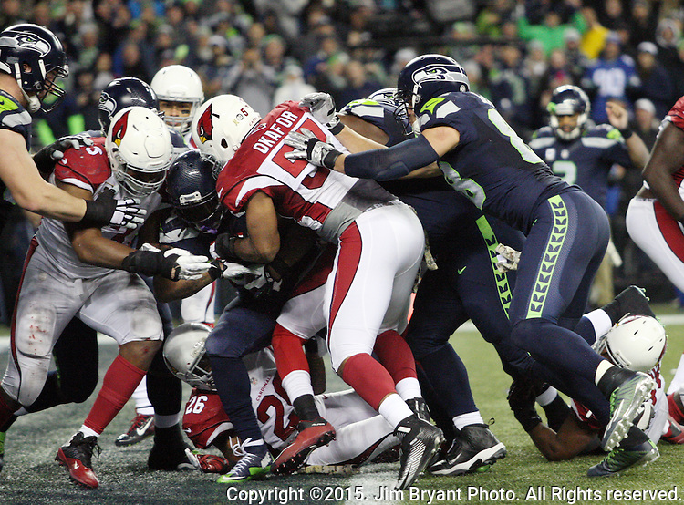 Seattle Seahawks running back Marshawn Lynch (24) runs for a 3 yard touchdown against the Arizona Cardinals at CenturyLink Field in Seattle, Washington on November 15, 2015. The Cardinals beat the Seahawks 39-32.   ©2015. Jim Bryant photo. All Rights Reserved.