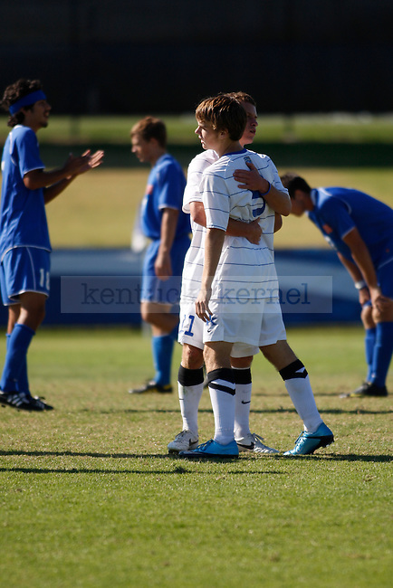 The UK men's soccer team played to a tie after two overtimes against Houston Baptist University Sunday afternoon. UK forward Jacob Kemper consoles fellow forward Tyler Riggs after a near-miss shot on goal. John Foster | Staff