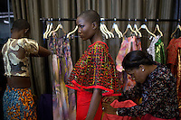 LAGOS, NIGERIA – DECEMBER 4: Cynthia Abdulahi, winner of Nigeria's Next Super Model 2013, is dressed before a show during the Africa International Fashion Week in the Lagos Oriental Hotel, Nigeria 2014<br /> (Photo by: Per-Anders Pettersson)