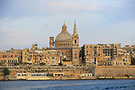Soft evening light on buildings and churches Valletta, Malta, dome Basilica of Our Lady of Mount Carmel church