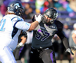 SIOUX FALLS, SD - NOVEMBER 8: Grant Schindler #57 from the University of Sioux Falls looks to shake the block of Nathan Cato #72 from Upper Iowa in the first quarter of their game Saturday afternoon at Bob Young Field in Sioux Falls.  (Photo by Dave Eggen/Inertia)