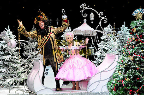 DAVID HASSELHOFF & BARBARA WINDSOR .First Family Entertainment theatre company's annual group Pantomime photocall at Piccadilly Theatre, London, England..November 26th, 2010.stage costume panto pantomime full length captain hook fairy godmother carriage sitting pink dress gold wig jacket hands arms in air funny .CAP/CAS.©Bob Cass/Capital Pictures.