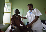Miriam Musa attends to a patient at the St. Daniel Comboni Catholic Hospital in Wau, South Sudan. Musa, a nurse, is a 2013 graduate of the Catholic Health Training Institute in Rumbek.