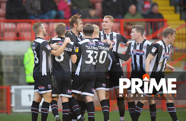 James Hanson of Grimsby Town celebrates with his teammates after scoring to make it 1-2 during the Sky Bet League 2 match between Crawley Town and Grimsby Town at The People's Pension Stadium, Crawley, England on 25 January 2020. Photo by Alan  Stanford / PRiME Media Images.