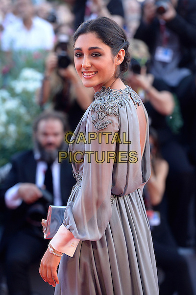 Golshifteh Farahani <br /> attending the Closing Ceremony of the 70th Venice International Film Festival at Palazzo del Cinema in Venice, Italy, September 7th 2013.<br /> half length grey gray long sleeve dress bubbles clutch bag silver side back over shoulder <br /> CAP/ZZG<br /> &copy;ZZG/Capital Pictures