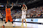 12 March 2015: Notre Dame's Steve Vasturia (32) shoots over Miami's Davon Reed (5). The Notre Dame Fighting Irish played the University of Miami Hurricanes in an NCAA Division I Men's basketball game at the Greensboro Coliseum in Greensboro, North Carolina in the ACC Men's Basketball Tournament quarterfinal game. Notre Dame won the game 70-63.