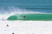 A surfer rides the barrel at Ehukai Beach Park on Oahu's North Shore.