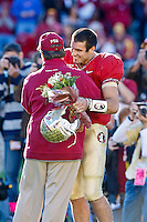 November 27, 2010:   Florida State Seminoles quarterback Christian Ponder (7) is greeted by head coach Jimbo Fisher during Senior day ceremonies before the start of the game between  the ACC Conference Florida State Seminoles and the SEC Conference University of Florida Gators at Doak Campbell Stadium in Tallahassee, Florida.