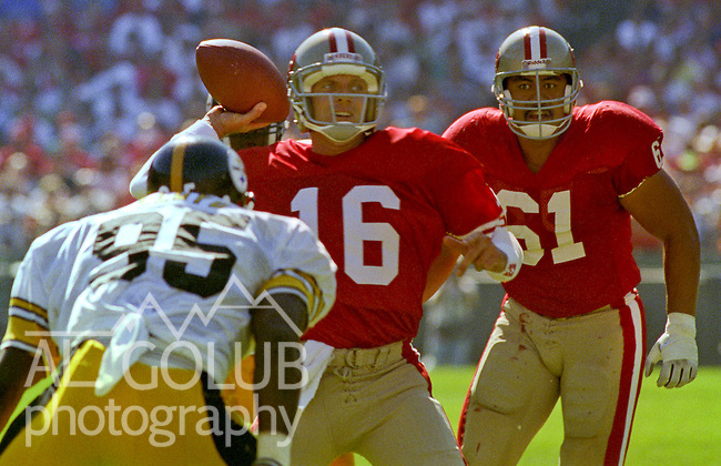 San Francisco 49ers vs Pittsburg Steelers at Candlestick Park Sunday, October 21, 1990..49ers beat Steelers 27-7.49er quarterback Joe Montana (16) passes over Steelers linebacker Greg Lloyd (95)..
