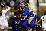 02 December 2011: Duke's Kim DeCesare (19) celebrates her goal with Natasha Anasi (4), and Katie Trees. The Duke University Blue Devils defeated the Wake Forest University Demon Deacons 4-1 at KSU Soccer Stadium in Kennesaw, Georgia in an NCAA Division I Women's Soccer College Cup semifinal game.