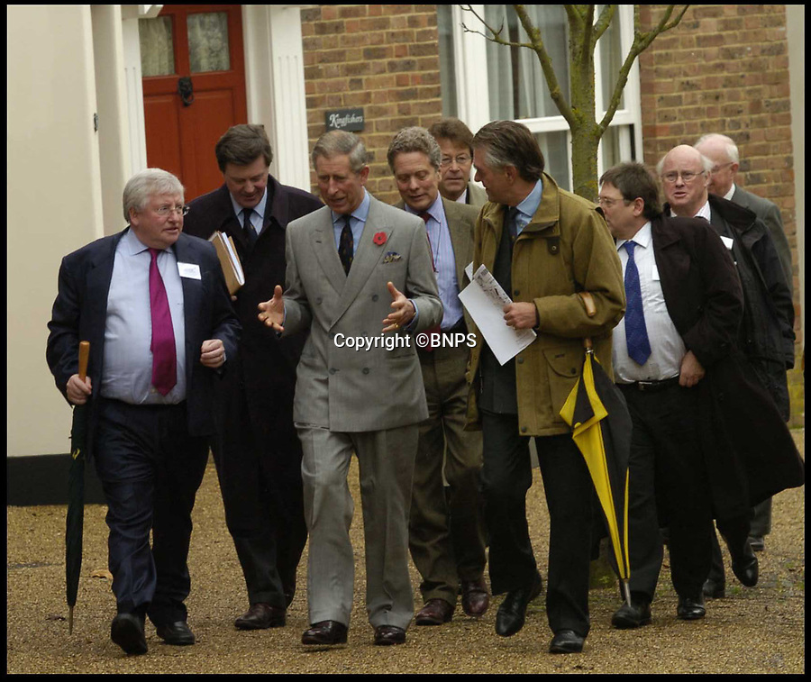 BNPS.co.uk (01202) 558833Pic: DanielRushall/BNPS<br /> <br /> Prince Charles visits Poundbury back in 2004.<br /> <br /> Prince William has followed in his father's footsteps and paid a personal visit to Prince Charles' designer village of Poundbury.<br /> <br /> The Duke of Cambridge's informal visit to the development on Duchy of Cornwall land in Dorset took in many of the places his father has named in honour of members of the Royal Family.<br /> <br /> The Duke visited a butchers shop in Queen Mother Square where there is a 10ft brostatue of his late great-grandmother as well as palatial block of flats that looks like Buckingham Palace.<br /> <br /> The square is also home to the pub called the Duchess of Cornwall, after Prince William's stepmother Camilla.
