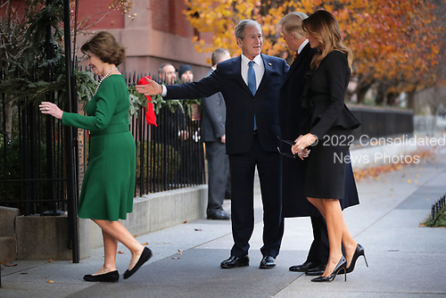 Former first lady Laura Bush and former President George W. Bush greet first lady Melania Trump and President Donald Trump outside of Blair House December 04, 2018 in Washington, DC. The Trumps were paying a condolence visit to the Bush family who are in Washington for former President George H.W. Bushs state funeral and related honors. <br /> Credit: Chip Somodevilla / Pool via CNP
