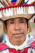 A Mexican indigenous man in traditional dress looks at the camera first ever International Indigenous Games, in the city of Palmas, Tocantins State, Brazil. Photo © Sue Cunningham, pictures@scphotographic.com 22nd October 2015