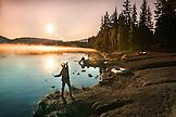 USA, Oregon, Paulina Lake, Brown Cannon, a fisherman fishes off the shoreline at Paulina Lake
