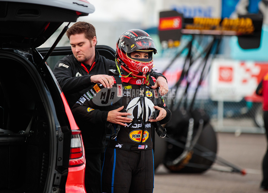 Feb 22, 2019; Chandler, AZ, USA; Crew member for NHRA top fuel driver Leah Pritchett during qualifying for the Arizona Nationals at Wild Horse Pass Motorsports Park. Mandatory Credit: Mark J. Rebilas-USA TODAY Sports