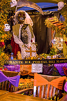 Oaxaca, Mexico, North America.  Day of the Dead Celebrations.  Hotel Display in Honor of Oaxacan Traditions and Artists.  Skeleton, Marigold Flowers, Skulls.