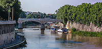 Fine, Art, Landscape, Photograph, of the Tiber, River. The curved road and colourful blue sky Frame the bridge,