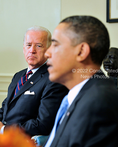 United States Vice President Joseph Biden, left, looks on as U.S. President Barack Obama, right, makes remarks to the press as he meets bipartisan leaders of the Senate and the bipartisan leaders of the Senate Judiciary Committee in the Oval Office to discuss the Supreme Court vacancy left by the retirement of Justice Stevens in Washington, D.C. on Wednesday, April 21, 2010.  .Credit: Ron Sachs / Pool via CNP