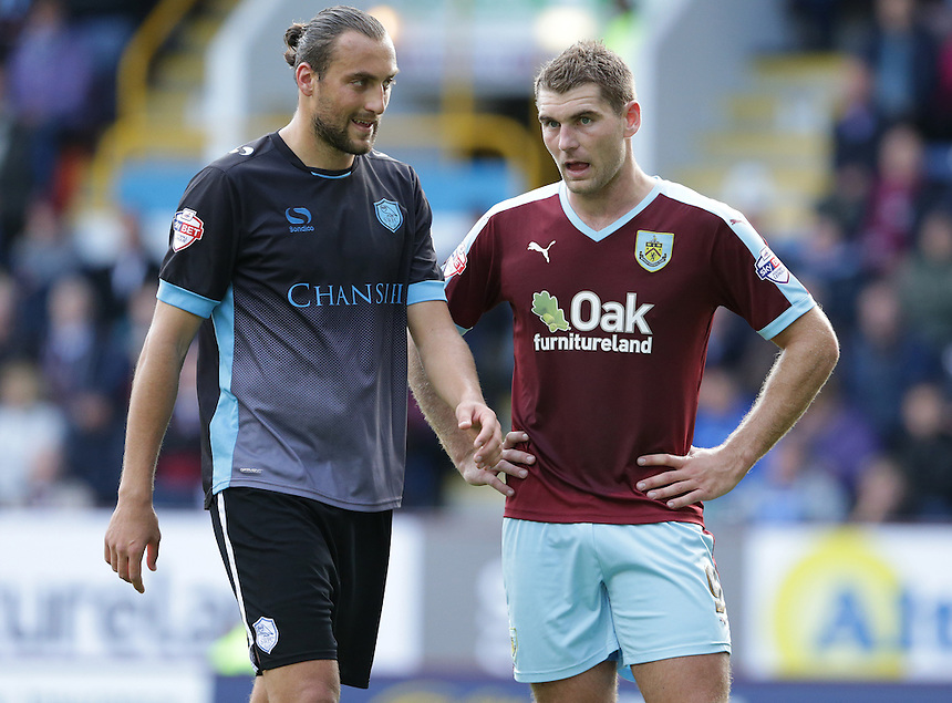 Sheffield Wednesday's Atdhe Nuhiu keeping a close eye on Burnley's Sam Vokes<br /> <br /> Photographer Stephen White/CameraSport<br /> <br /> Football - The Football League Sky Bet Championship - Burnley v Sheffield Wednesday - Saturday 12th September 2015 -  Turf Moor - Burnley<br /> <br /> &copy; CameraSport - 43 Linden Ave. Countesthorpe. Leicester. England. LE8 5PG - Tel: +44 (0) 116 277 4147 - admin@camerasport.com - www.camerasport.com