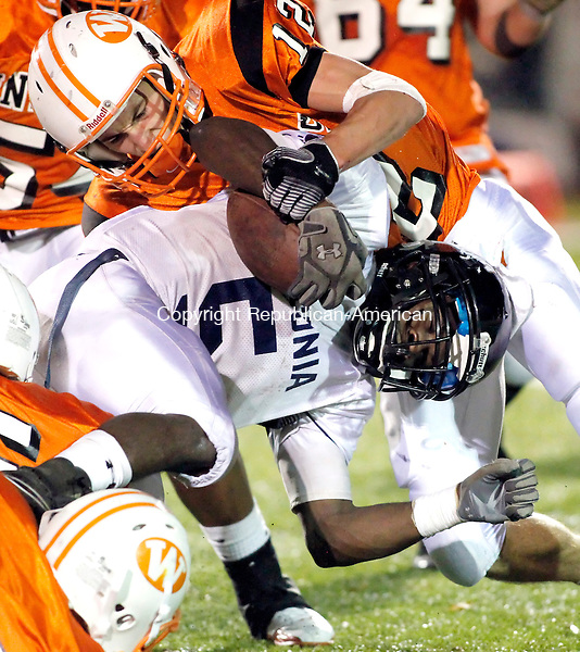 Watertown, CT- 22, October 2010-102210CM10 Watertown's Matt Quatrano takes down Ansonia's Montrell Dobbs, Thursday night in Watertown.  Ansonia routed the Indians, 47-23.   Christopher Massa Republican-American