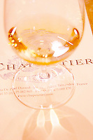 A glass of white Hermitage on a white background with the text Chapoutier in the tasting room.  Domaine M Chapoutier, Tain l'Hermitage, Drome Drôme, France Europe