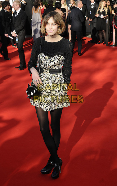 ALEXA CHUNG.Arrivals at the British Academy Television Awards 2009, Royal Festival Hall, London, England. .April 26th 2009 .TV Baftas bafta's full length black dress top strapless white print waist belt skinny legs tights shoes bag cat t-bar hand in pocket .CAP/CAN.©Can Nguyen/Capital Pictures.