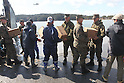OSHIMA, Japan - Marines of the 31st Marine Expeditionary Unit, Sailors with Amphibious Squadron 11, Japanese Ground Self Defense Forces, and local citizens unload food and water from a U.S. Navy landing craft, March 27. The 31st MEU and PHIBRON 11 picked up Japanese utility repair vehicles from the port in Kessenuma and delivered food, water, comfort items and the vehicles to residents on this isolated island. The island of Oshima has been cut off from the mainland since the earthquake and tsunami March 11. The operation demonstrated the expeditionary capabilities in ship-to-shore amphibious operations. Marines and Sailors of the 31st MEU are conducting humanitarian aid and disaster relief missions in northeast Japan assisting the Japanese Self Defense Forces in their ongoing operations. (Photo by USMC/AFLO) [0006]