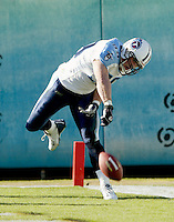 Tennessee Titans linebacker Peter Sirmon spikes the ball in the end zone after intercepting a pass and returning it for a touchdown during a game against the Jacksonville Jaguars in Jacksonville, FL on Sunday, December 22, 2002.  Tennessee won the game 28 to 10. (Photo by Brian Cleary/www.bcpix.com)