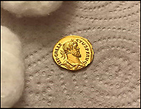 BNPS.co.uk (01202 558833)<br /> Pic: DNW/BNPS<br /> <br /> The stunning coin after it was lightly cleaned.<br /> <br /> Primus Brexitus! - £100,000 gold coin from the first British exit from Europe discovered near Dover<br /> <br /> A lucky detectorist has struck gold after finding <br /> a stunning Roman Aureus of self proclaimed Emperor Allectus, who briefly ruled an independent Britain after it broke away from the Roman Empire in the late 3rd century AD.<br /> <br /> The detectorist found the coin last month near an old Roman road from the seaside town and after notifying the British museum it can now be sold.<br /> <br /> The incredibly well preserved coin is in mint condition looking as fresh as it did when lost over 1700 years ago.