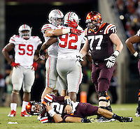 Ohio State Buckeyes defensive lineman Adolphus Washington (92) celebrates his hit on Virginia Tech Hokies quarterback Michael Brewer (12) that knocked him out of the game in the 3rd quarter at Lane Stadium in Blacksburg, Va on September 7, 2015.  (Dispatch photo by Kyle Robertson)