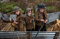 BNPS.co.uk (01202 558833)<br /> Pic: PhilYeomans/BNPS<br /> <br /> l-r Mae, Jake and Martina - students of Garth Hill College in Bracknell get used to life in the trenches.<br /> <br /> Class War - A school has turned part of its playground into a replica First World War trench system that makes an fascinating and poignant living history classroom.<br /> <br /> The scaled down trenches allows pupils to get an authentic, hands-on lesson on what life and conditions were like for the unfortunate soldiers who served on the Western Front. <br /> <br /> As well as being given educational talks, students also get muddy taking part in re-enactment demonstrations in the trenches. <br /> <br /> The attention to detail includes replica rifles, bayonets, shell casings and even models of the ever present rats.<br /> <br /> The outdoor classroom is the first of its kind in the country and schools from miles around are booking up visits for their students to experience the real feel of the award winning movie 1917.