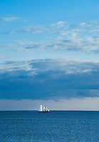 Sailboat at full sail on a pristine ocean, Cape Cod, MA, USA