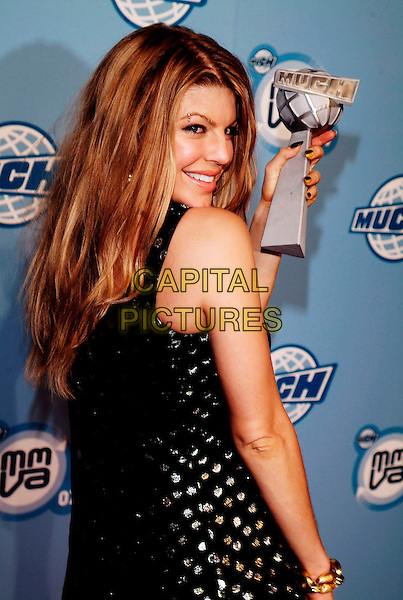 FERGIE - STACY FERGUSON.At the 18th Annual MuchMusic Video Awards, Chum/City Building, Toronto, Ontario, Canada,17 June 2007..half length Much Music stacey black gold and silver beaded mini dress trophy winner back over shoulder.CAP/ADM/BP.©Brent Perniac/AdMedia/Capital Pictures.