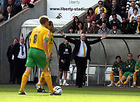 ATTENTION SPORTS PICTURE DESK<br /> Pictured: Bryan Gunn, manager for Norwich raises his hands as he protests to the match referee<br /> Re: Coca Cola Championship, Swansea City FC v Norwich City FC at the Liberty Stadium Swansea, south Wales. Saturday 11 April 2009.<br /> Picture by D Legakis Photography / Athena Picture Agency, Swansea 07815441513