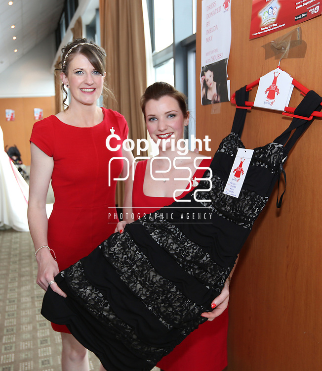 25/5/2014  (with compliments)  The Buy My Dress campaign took place on Sunday around the country in aid of the Down Syndrome Centre.  Attending the Limerick event were Caragh O'Shea from Clare and Muireann, McMullin, Donegal with an Imelda May black lace dress byAfter Six.<br /> Picture Liam Burke/Press 22<br /> Buy My Dress is an initiative to get women throughout Ireland to donate a once loved dress that is now either too big, too small or bought on impulse and barely worn to be sold on at Ireland&rsquo;s largest one day Charity Dress Sale. A perfect event in this current economy where a new little number can be bought for a mere snip of it&rsquo;s original price. Most dresses range from between &euro;10 - &euro;50.<br /> <br /> Businesses around Ireland come on board and ask their staff and friends to donate to the cause and some Business&rsquo; are kind enough to act as a drop off point for the general public. For retailers this can be an added bonus getting footfall across the door. We also encourage ladies to organise &ldquo;Girls Nights In&rdquo; or coffee mornings where friends and colleagues bring along a dress to the occasion.<br /> <br /> Another option for donating is to send your dress FREEPOST to The Down Syndrome Centre, Unit 405, Q House, Furze Road, Sandyford Industrial Estate.<br /> <br /> As well as donations from the general public the increase in donations from celebrities increases with every year. Last year we received a record amount from Imelda May, Pixie Lott, Saoirse Ronan, Amy Hubberman&rsquo;s IFTA dress, Miriam O&rsquo;Callaghan, Glenda Gilson, Jackie Lavin, Sile Seoige, Laura Whitmore to mention a few.