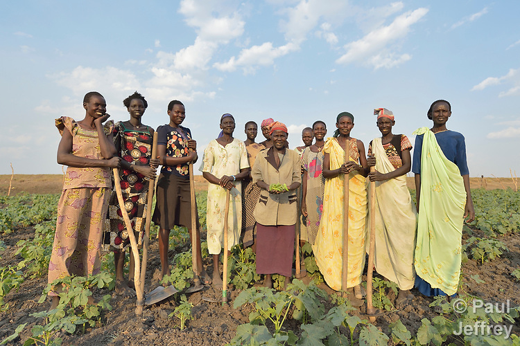 Women pose together after working in a community vegetable garden on April 12, 2017, in Dong Boma, a Dinka village in South Sudan's Jonglei State. Most of the women's families recently returned home after being displaced by rebel soldiers in December, 2013, and they face serious challenges in rebuilding their village while simultaneously coping with a drought which has devastated their cattle herds.<br /> <br /> The Lutheran World Federation, a member of the ACT Alliance, is helping the villagers restart their lives with support for housing, livelihood, and food security.