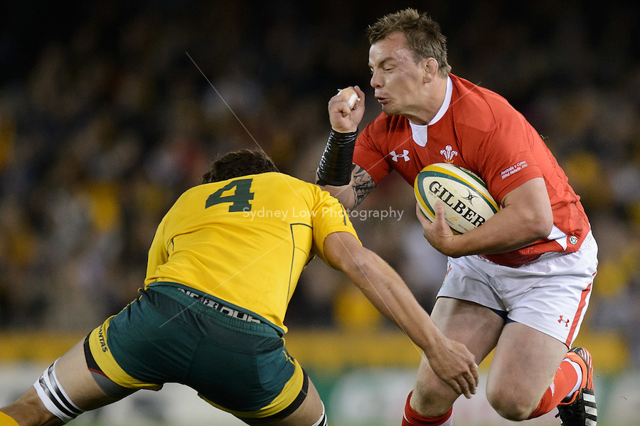 MELBOURNE, AUSTRALIA - JUNE 16: Matthew Rees of Wales runs with the ball during the 2nd match of the Castrol Edge Rugby series between the Australian Wallabies and Wales at Etihad Stadium. (Photo Sydney Low / sydlow.com)..Contact zumapress.com for editorial licensing.