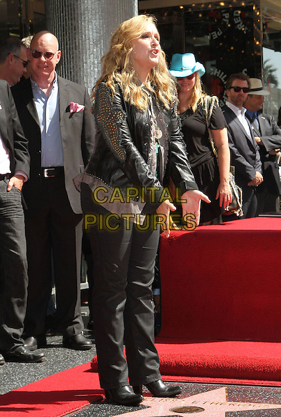 Melissa Etheridge.Melissa Etheridge Honored with a star on the Hollywood Walk of Fame  Held at On Hollywood Blvd., Hollywood, California, USA..27 September 2011 .full length black jacket jeans denim leather studs studded hands mouth open leaning bending side profile .CAP/ADM/KB.©Kevan Brooks/AdMedia/Capital Pictures.