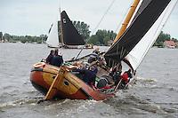 SKUTSJESILEN: GROU: SKS skûtsjesilen, Friese Sporten, 30-07-2011, Fryslân, skûtsje d'Halve Maen (Drachten) in achtervolging op It Doarp Grou, schipper Berend Mink, ©foto Martin de Jong