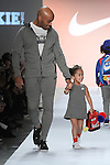 Former NY Giant Tiki Barber walks runway with his daughter Brooklyn Barber in outfits from the NIKE Fall 2017 children's collection, during the Rookie USA Fall 2017 kidswear fashion show, presented by Haddad Brands at NYFW: The Shows Fall 2017 at Skylight Clarkson Square on February 15, 2017.