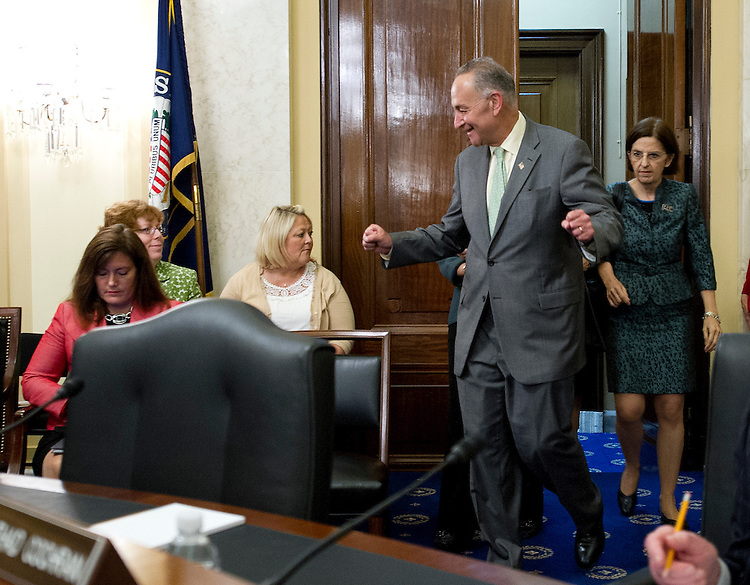 UNITED STATES - July 24 : Chairman Charles Schumer, D-NY., gives a fist pump as he enters the Rules & Administration Committee's business meeting to consider S.375, to require Senate candidates to file designations, statements and reports in electronic form, and also followed by a hearing for the nomination of Davita Vance-Cooks, of Virginia, to be Public Printer, GPO and FEC nominations of California regulator Ann Ravel and Virginia lawyer Lee Goodman on July 24, 2013. (Photo By Douglas Graham/CQ Roll Call)