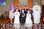 HOLY COMMUNION: The puplis of Ballyduff NS at their First Holy Communion at St Peter and St Paul Church, Ballyduff on Saturday front l-r: Laura Dineen, Shane Griffin and Emma Cronin. Back l-r: Ms Maura Enright, Oisin O'Connor, David Whyte, Muiris O'Connor, Sean Allen and Fr Brendan Walsh.
