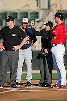(L-R) Umpire Ryan Barneycastle, Hagerstown Suns manager Patrick Anderson (22), umpire David Martinez, and Kannapolis Intimidators manager Cole Armstrong (33) go over the grounds rules prior to the South Atlantic League game at Kannapolis Intimidators Stadium on May 4, 2016 in Kannapolis, North Carolina.  The Intimidators defeated the Suns 7-4.  (Brian Westerholt/Four Seam Images)