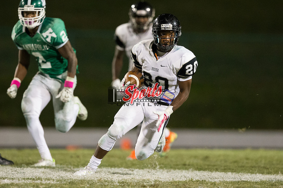 Geoffrey Cloud (20) of the Hough Huskies runs with the football during first half action against the A.L. Brown Wonders at A.L. Brown High School on October 16, 2015 in Kannapolis, North Carolina.  The Huskies defeated the Wonders 21-7.  (Brian Westerholt/Sports On Film)