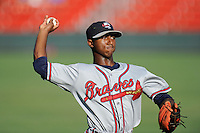 Shortstop Ozhaino Albies (7) of the Rome Braves warms up before a game against the Greenville Drive on Friday, June 12, 2015, at Fluor Field at the West End in Greenville, South Carolina. Greenville won, 10-8. (Tom Priddy/Four Seam Images)