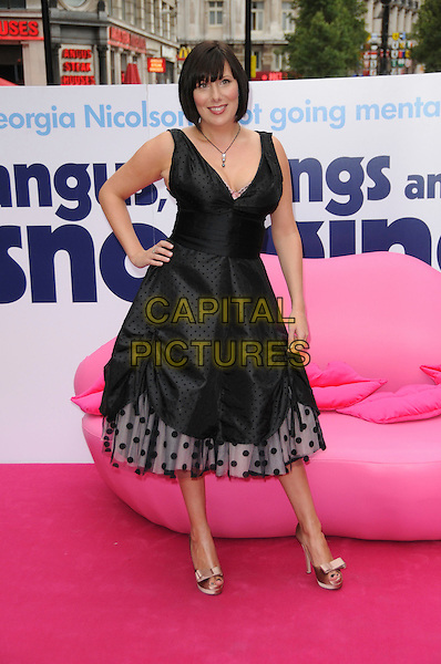 """KAREN TAYLOR .At the UK Film Premiere of """"Angus, Thongs and Perfect Snogging"""", Empire cinema, Leicester Square, London, England, July 16th 2008..full length black dress hand on hip polka dot bow shoes bows.CAP/CAS.©Bob Cass/Capital Pictures"""